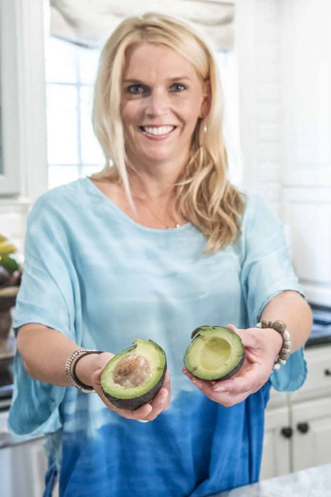 Laura Silsbee holding avocados